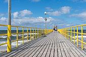 Ustronie Morskie pier at summer day.