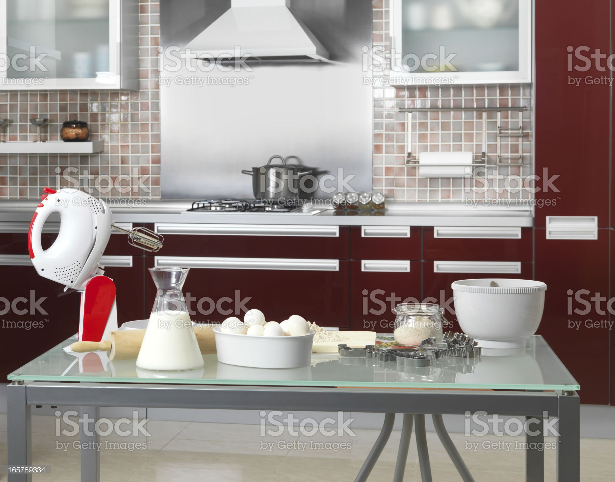 Utensils and cooking ingredients in kitchen royalty-free stock photo