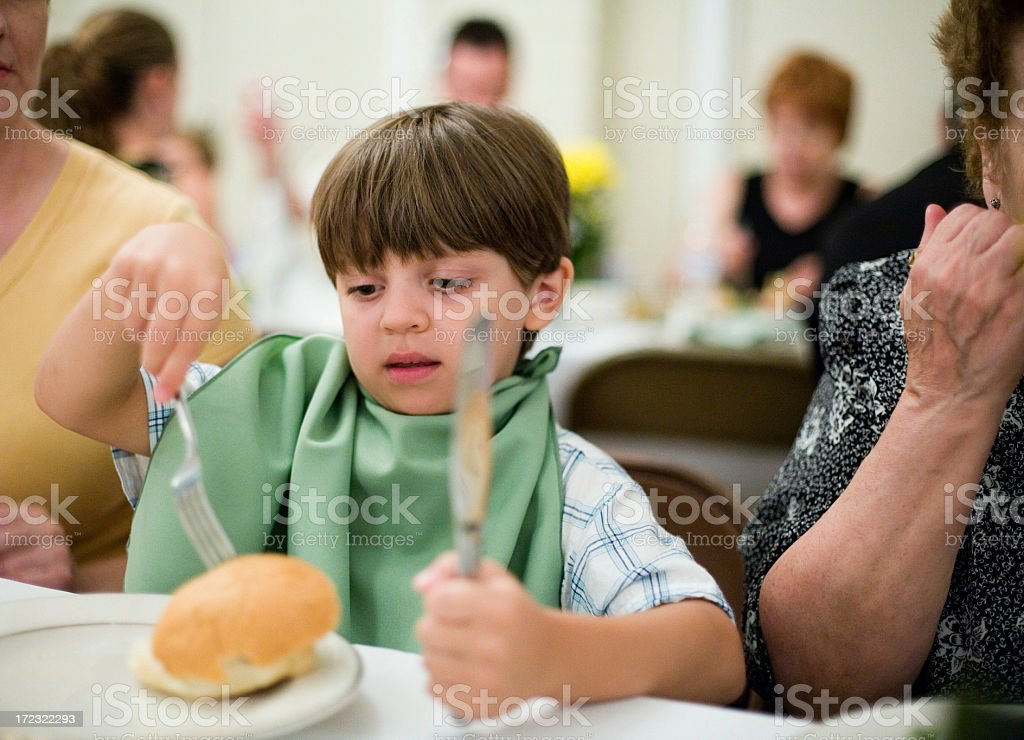 Utensils in childs hands royalty-free stock photo