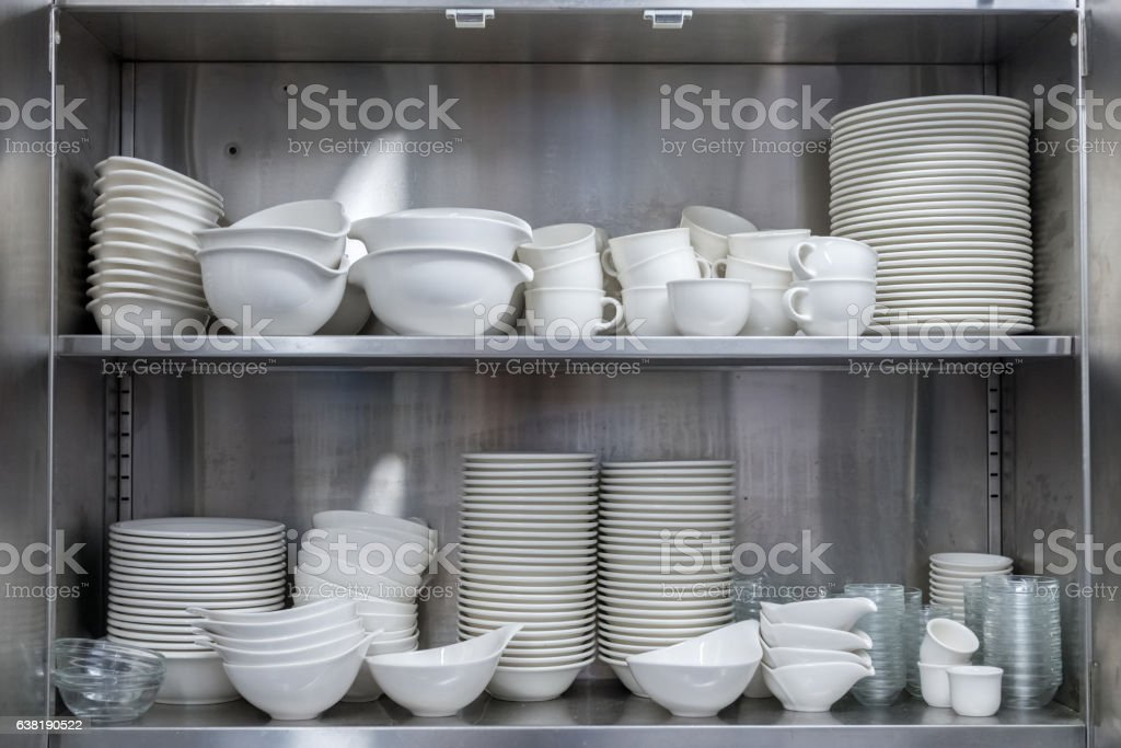 utensils in the kitchen cupboard stock photo