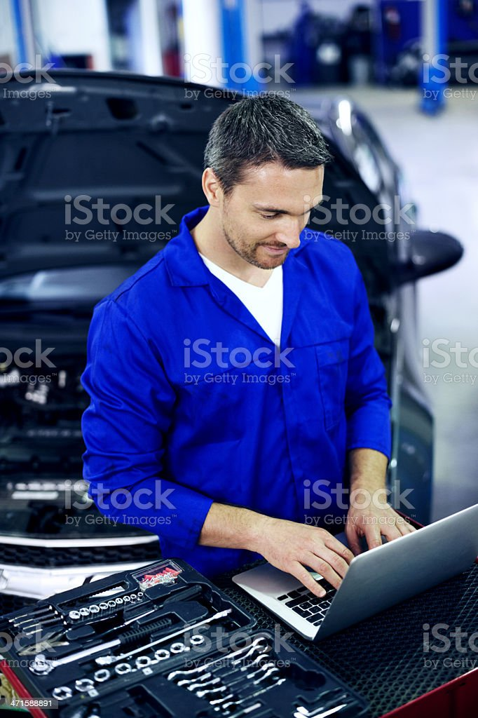 Utilising technology to keep his knowledge up-to-date! royalty-free stock photo