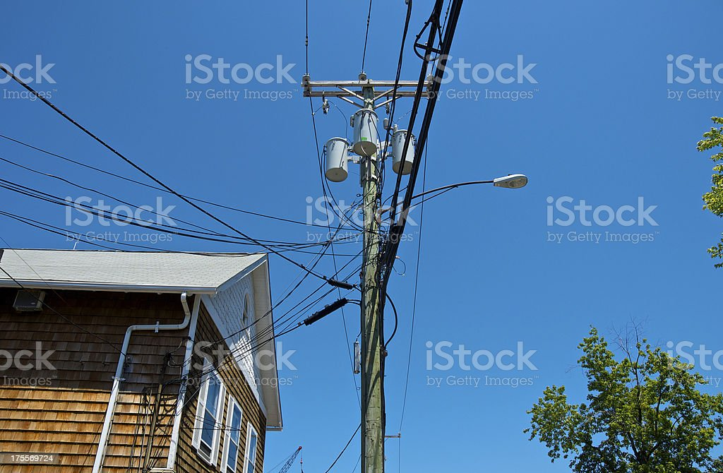 Utility lines & pole, building, New England, United States royalty-free stock photo