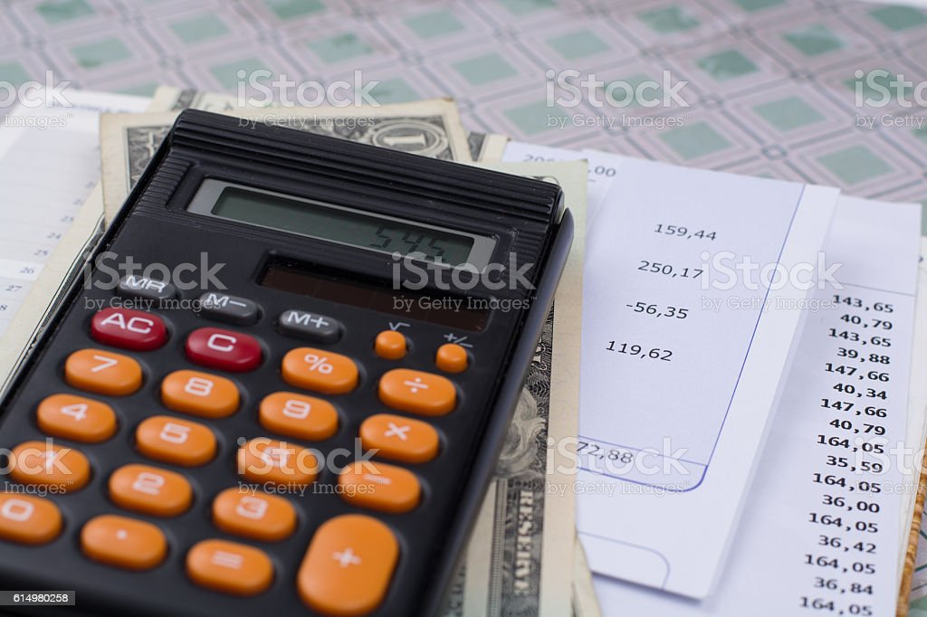 Utility or mortgage bills, calculator and US dollars finance concept stock photo