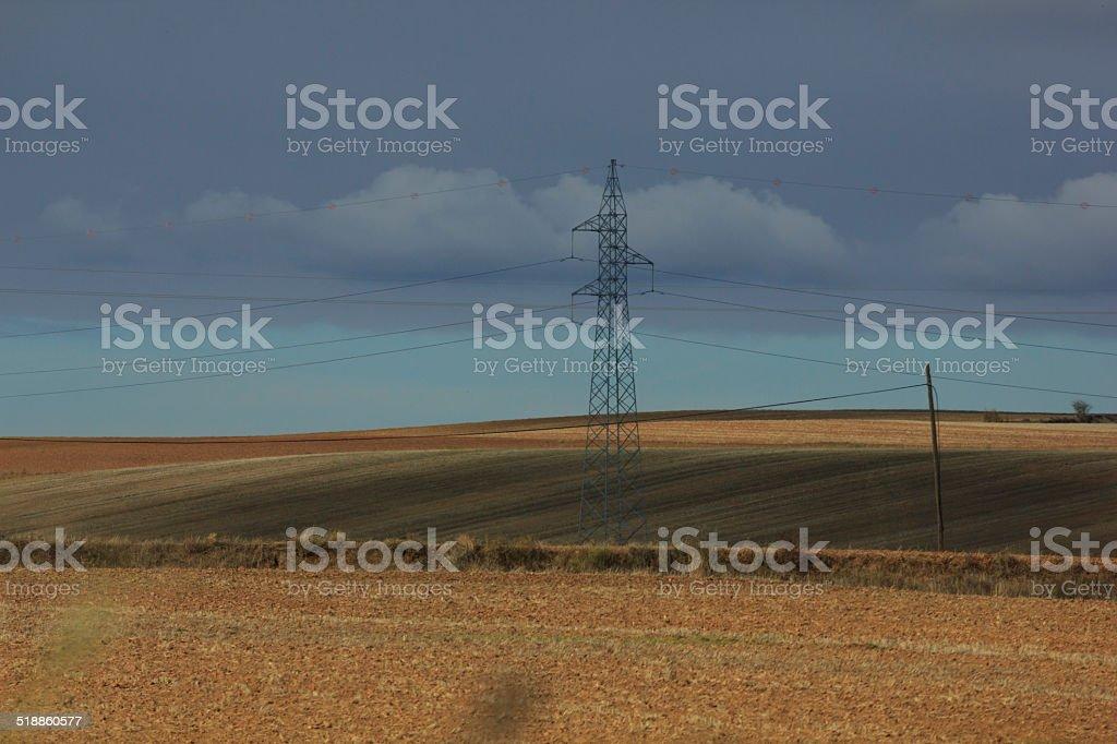 utility poles at sunset stock photo