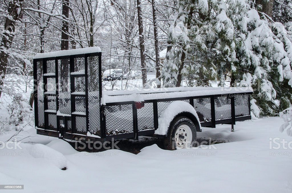 Utility Trailer Covered With Snow stock photo