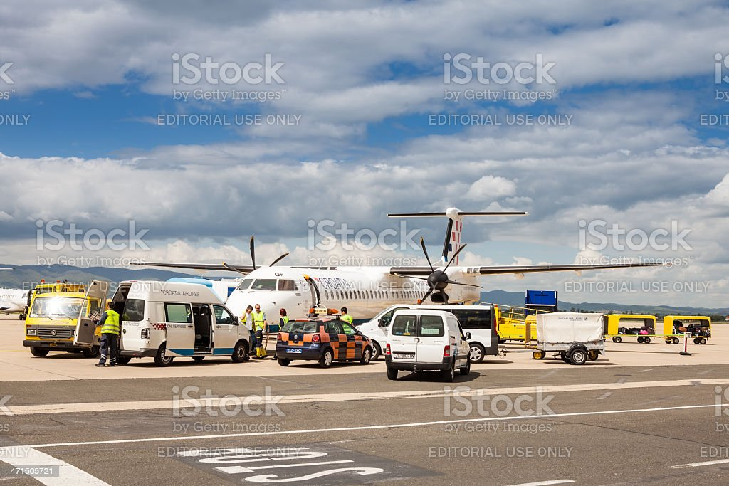 Utility vehicles around Croatia Airlines airplane at Zagreb airport stock photo