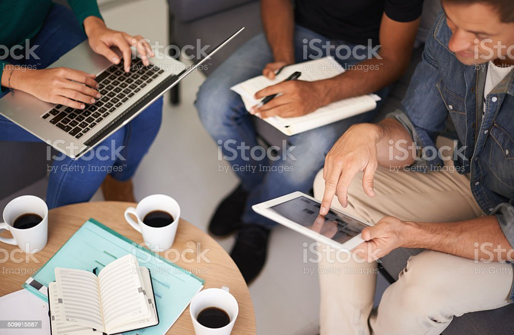 Utilizing tech to make their meetings more efficient stock photo