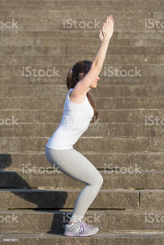 Utkatasana pose exercise stock photo