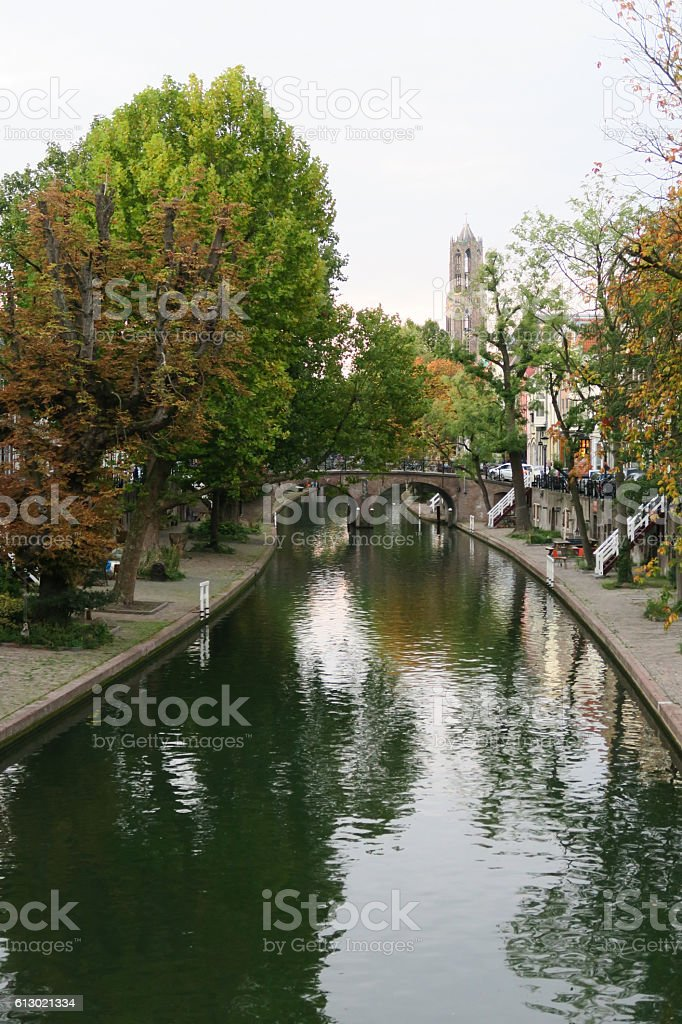 utrecht canal and dom in autumn tree reflection and bridge stock photo