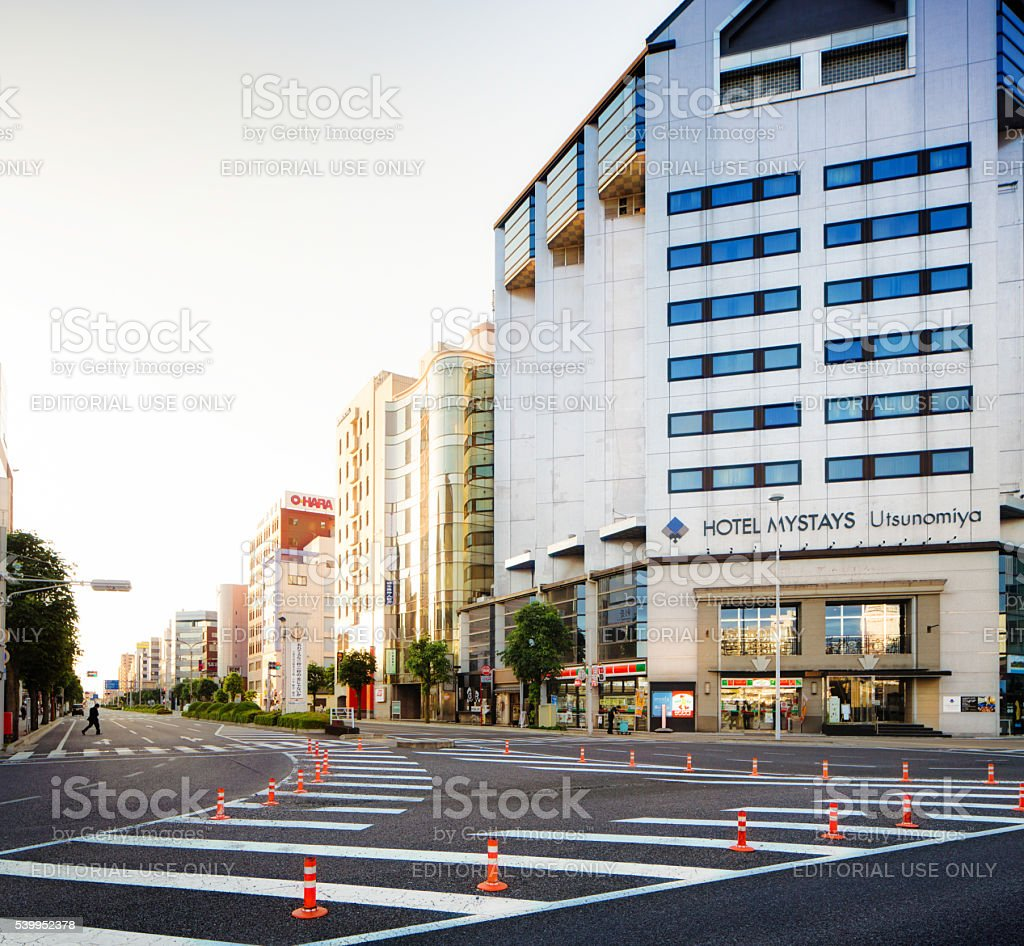 Utsunomiya Kinu Dori at dawn featuring Hotel Mystays stock photo