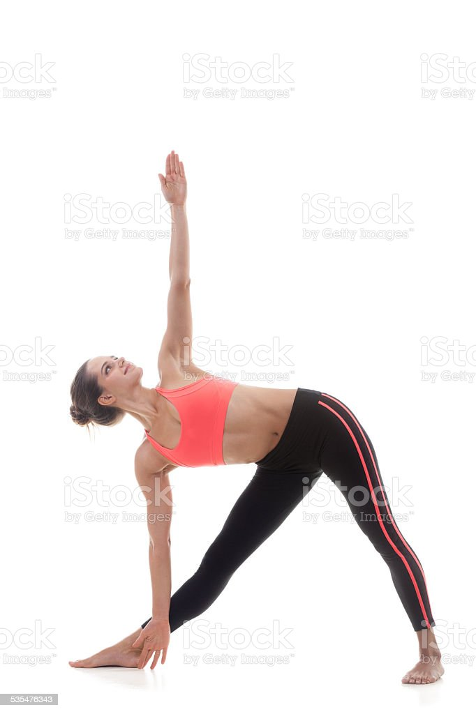 Utthita trikonasana (extended triangle pose) stock photo