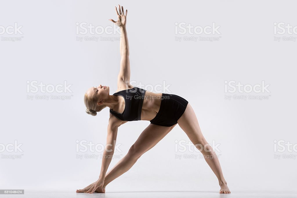 Utthita Trikonasana pose stock photo