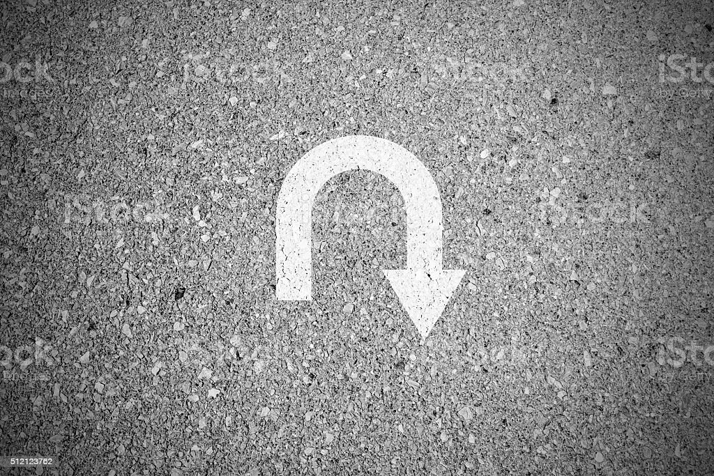 U-turn sign on asphalt concrete street stock photo