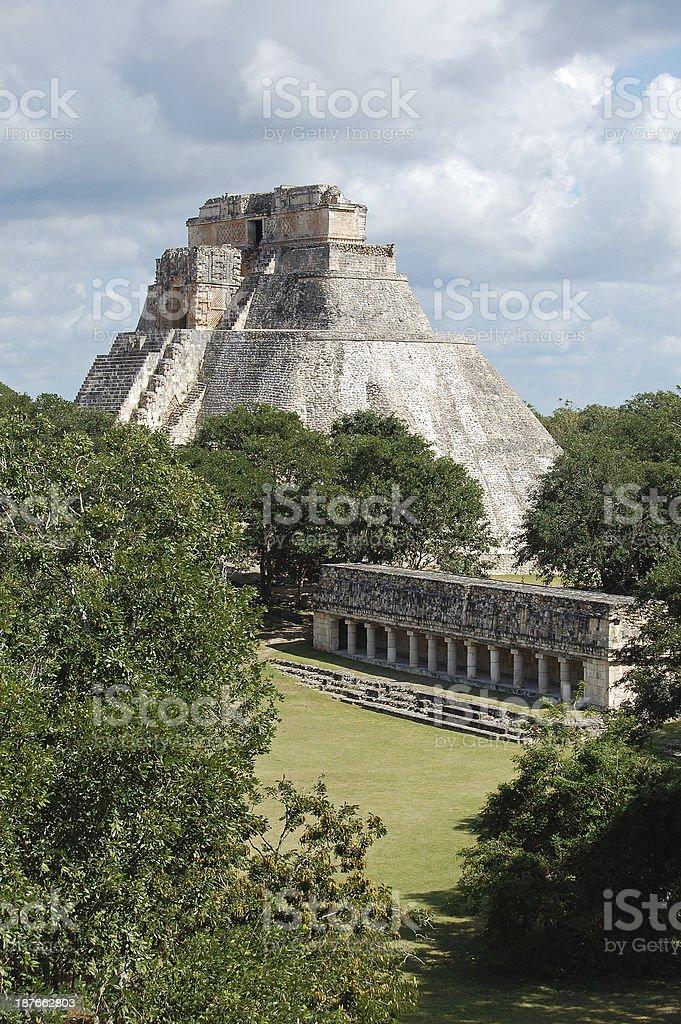 Uxmal Pyramid of the Magician and Colonnade Vertical Yucatan Mexico royalty-free stock photo