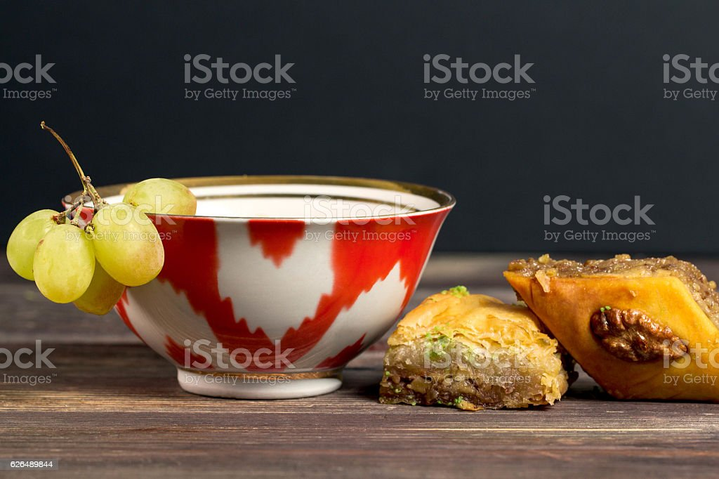 Uzbek green tea Cup and Oriental sweets honey baklava stock photo
