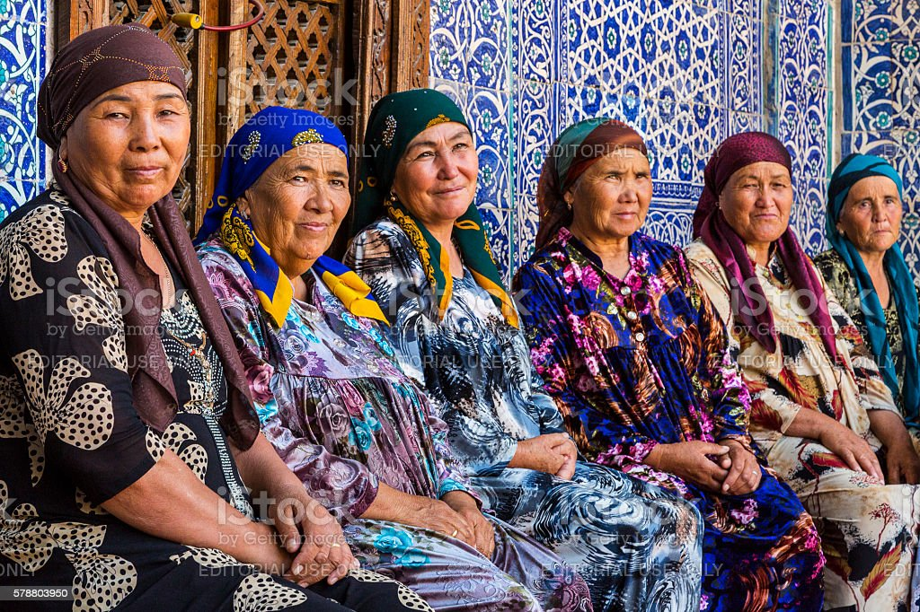 Uzbek women in colorful dresses. stock photo