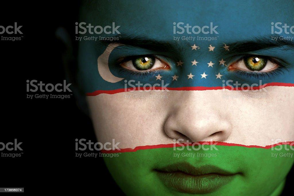 Uzbekistan flag boy stock photo