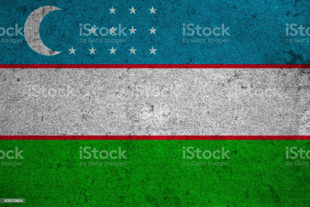 Uzbekistan flag on an old grunge background stock photo