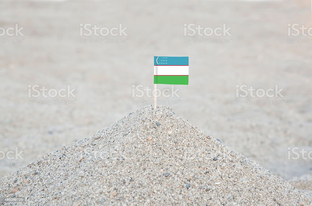 Uzbekistan Flag on the Beach stock photo