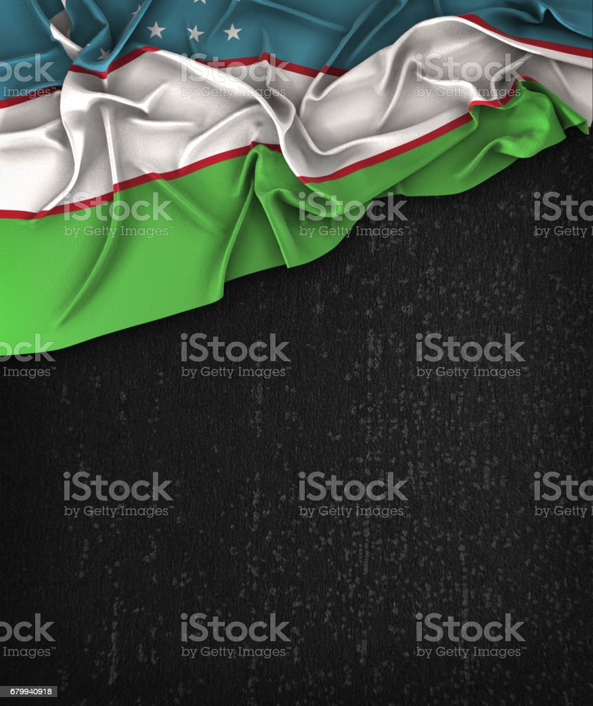 Uzbekistan Flag Vintage on a Grunge Black Chalkboard With Space For Text stock photo