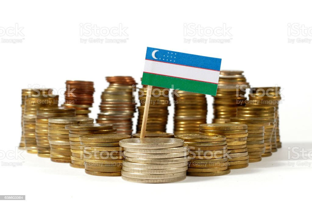 Uzbekistan flag waving with stack of money coins stock photo