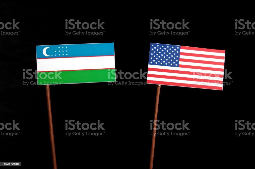 Uzbekistan flag with USA flag isolated on black background stock photo