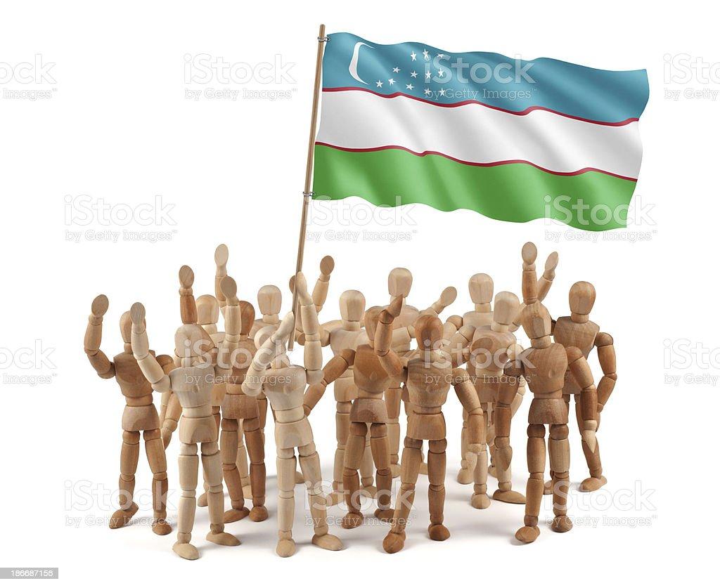 Uzbekistan - wooden mannequin group with flag stock photo