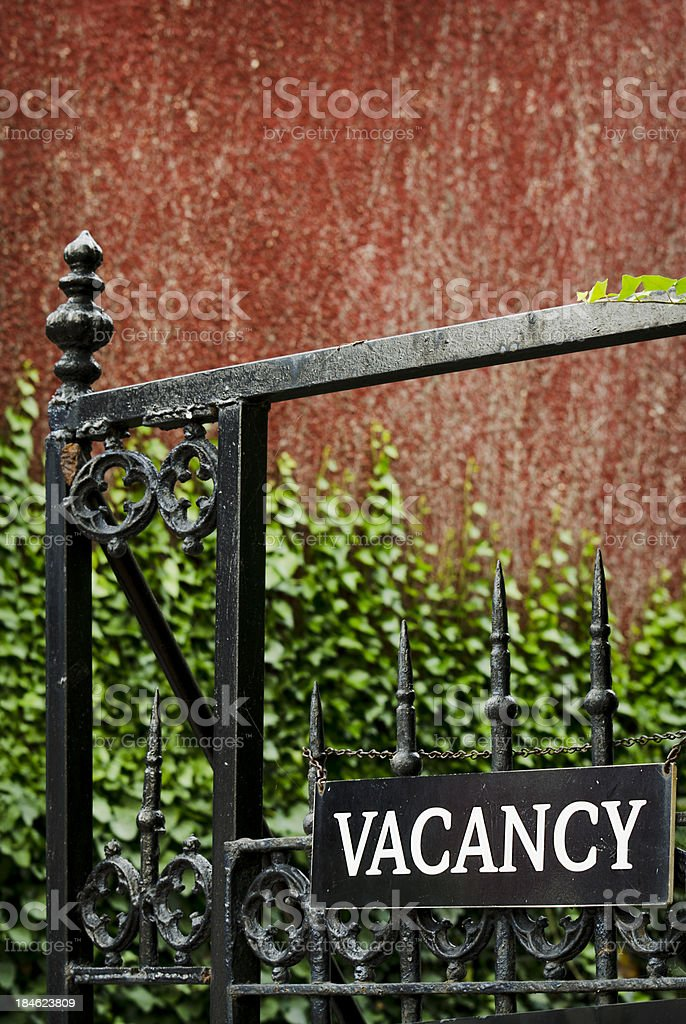 Vacancy Sign on Antique Wrought Iron Gate royalty-free stock photo