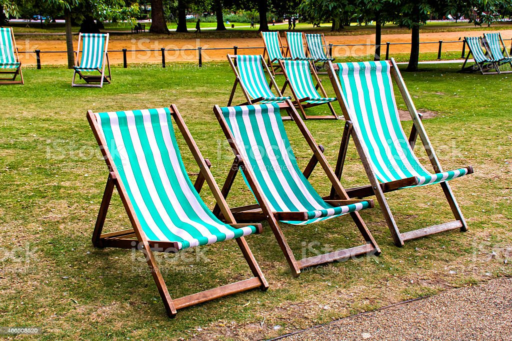 Vacant deck chairs in park stock photo