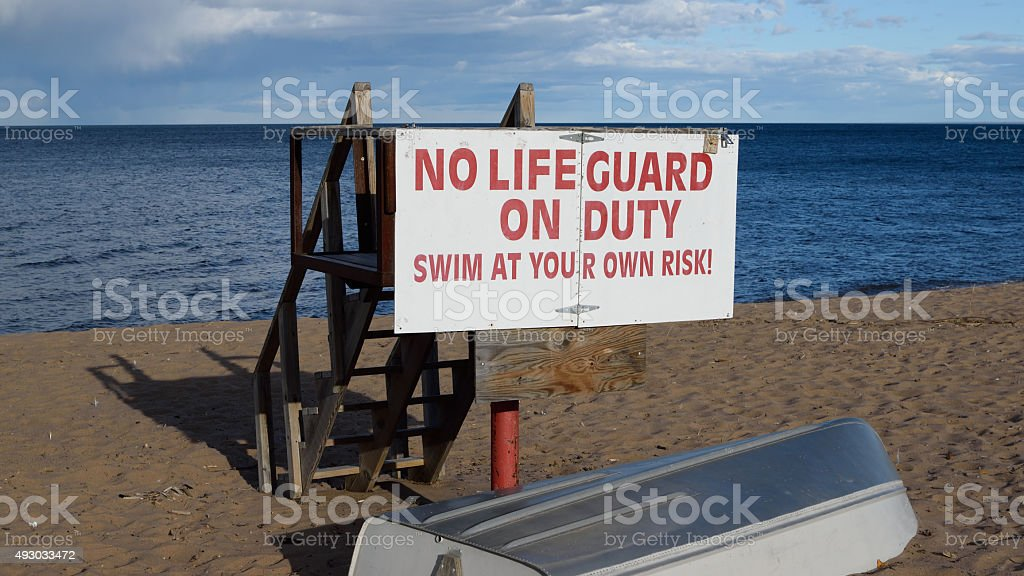 Vacant Lifeguard Station and Boat on Lake Superior stock photo