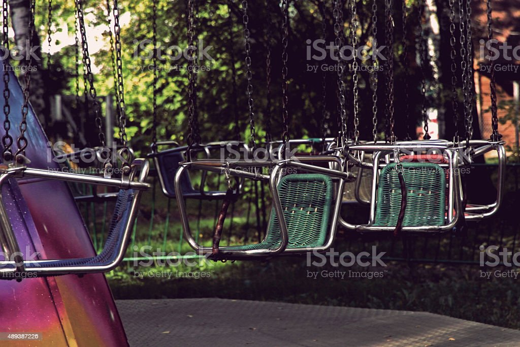 Vacant merry-go-round seats. stock photo