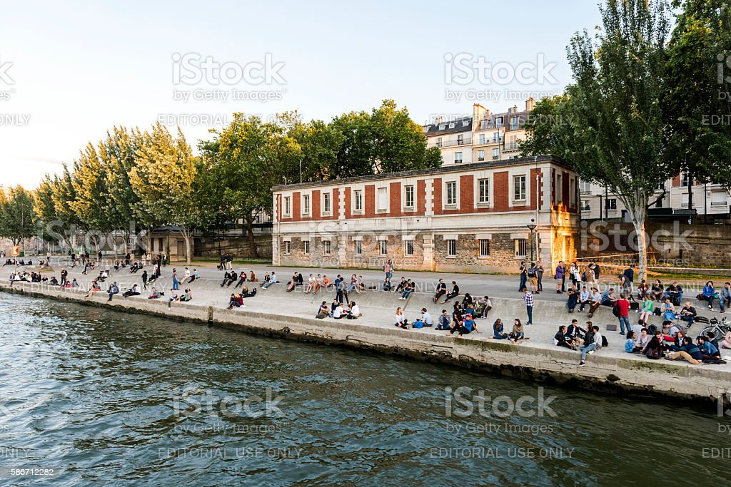 Vacation at the edge of the Seine River in Paris stock photo