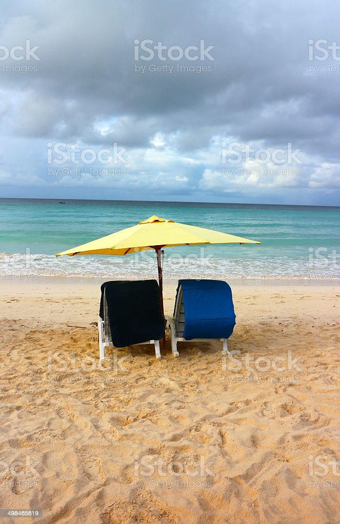 Vacation background.Tropical beach of Barbados with lounging chairs. royalty-free stock photo