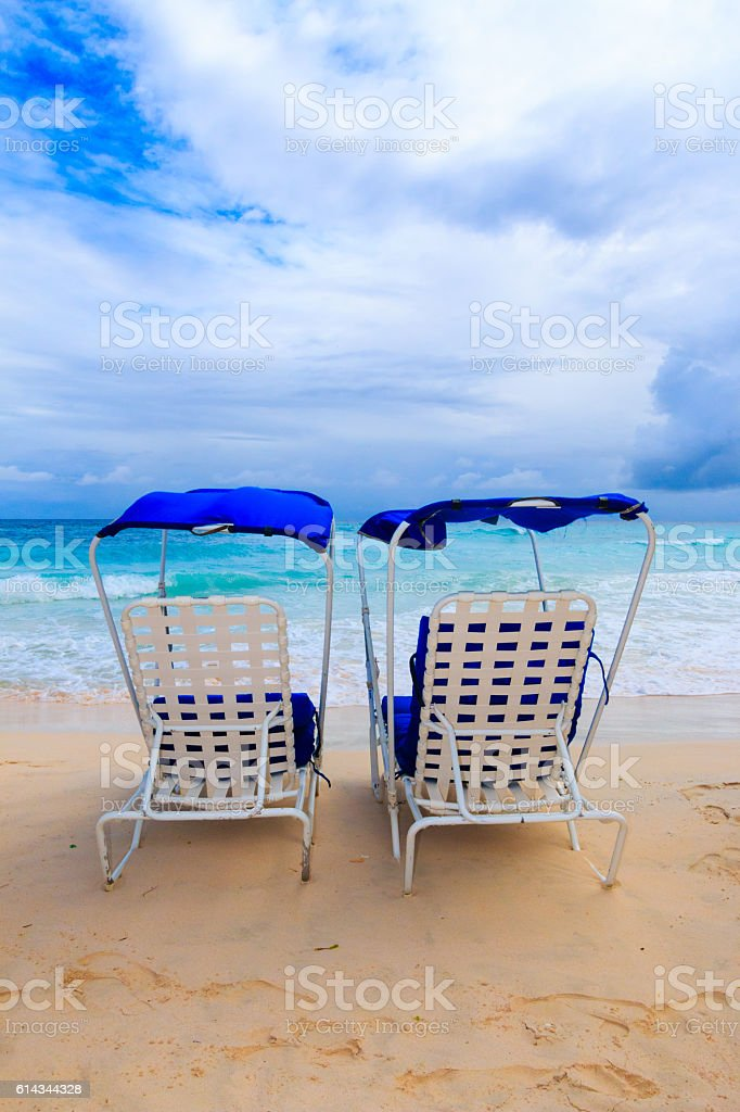 Vacation background.Tropical beach of Barbados with lounging chairs stock photo