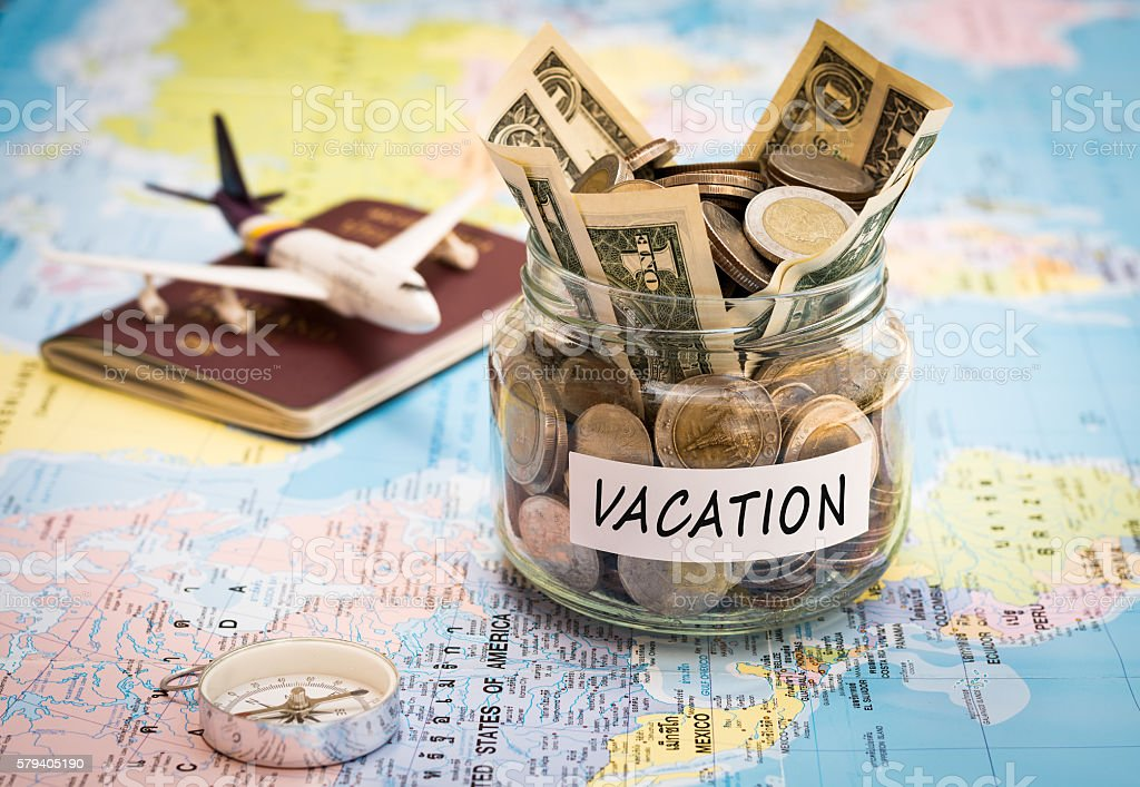 Vacation budget concept with compass, passport and aircraft toy stock photo