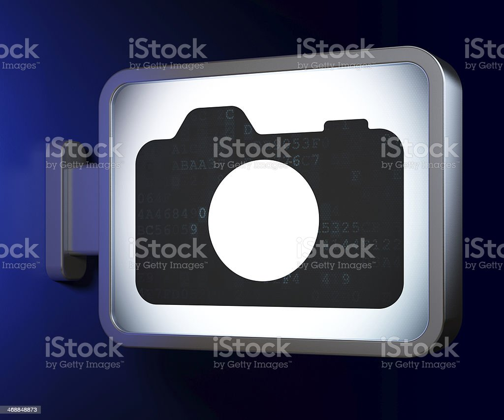 Vacation concept: Photo Camera on billboard background stock photo