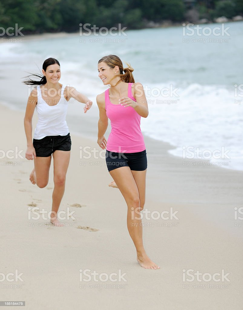 Vacation Fun - Jogging down the Beach royalty-free stock photo
