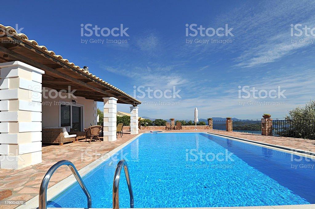 Vacation holiday villa and swimming pool, Greek Island of Lefkas royalty-free stock photo