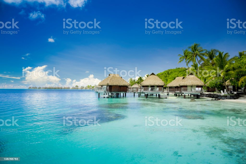 Vacation Huts on Ocean in French Polynesia stock photo
