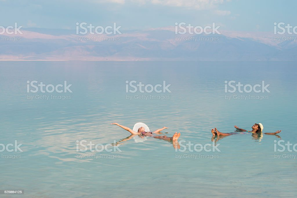 Vacation in Dead Sea with friends. stock photo