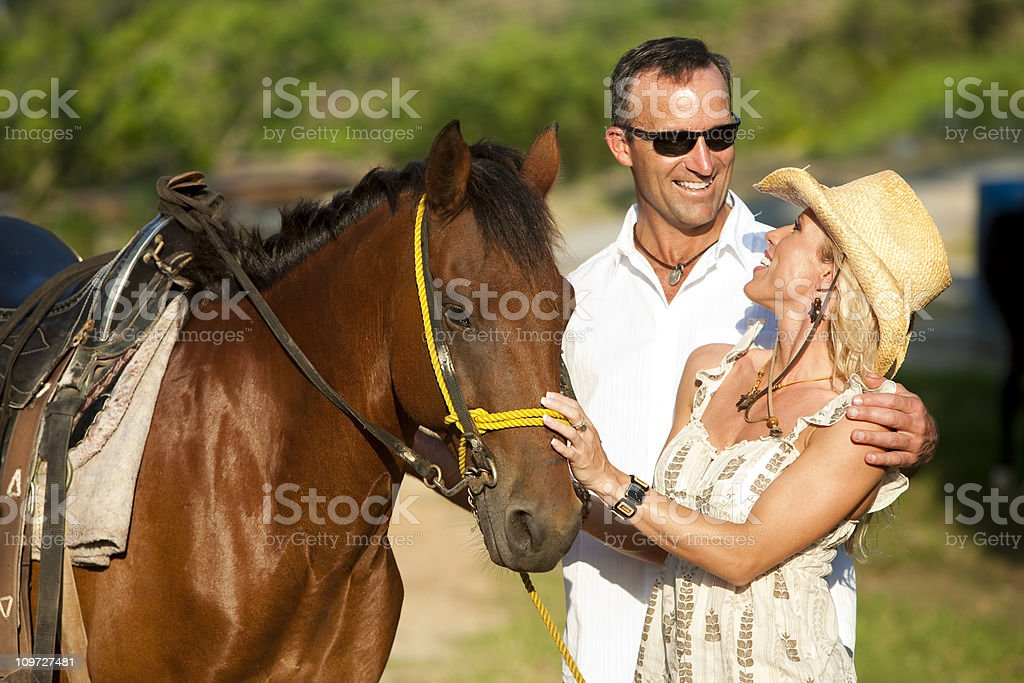 Vacation Lifestyles-Couple Horseback Riding royalty-free stock photo