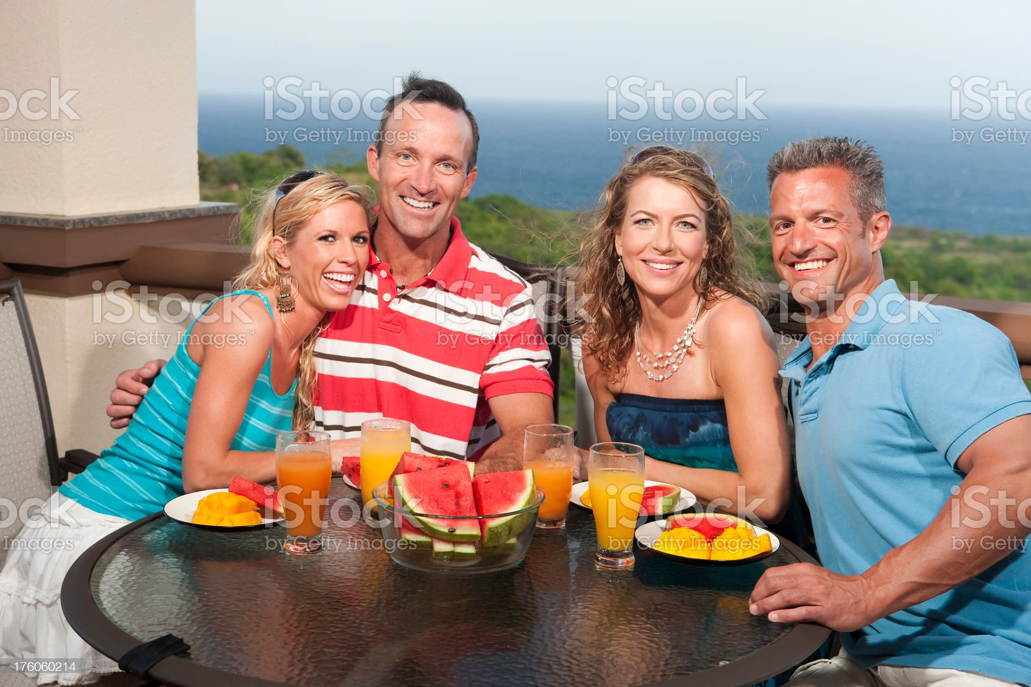 Vacation Lifestyles-Friends Eating on Balcony royalty-free stock photo