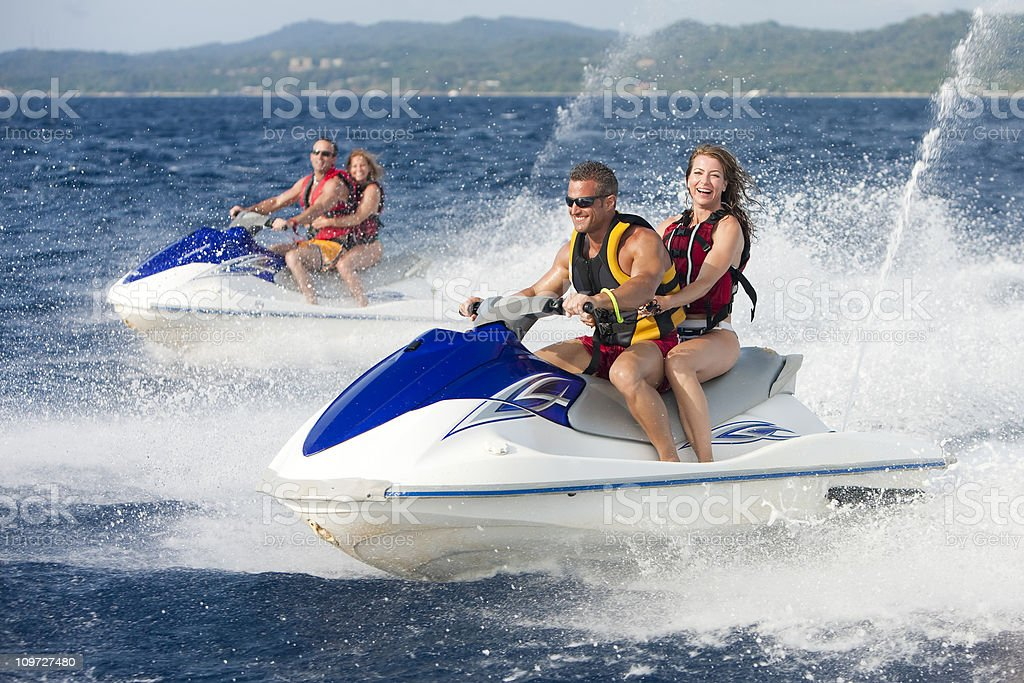 Vacation Lifestyles-Friends Riding Jet Skis Together royalty-free stock photo
