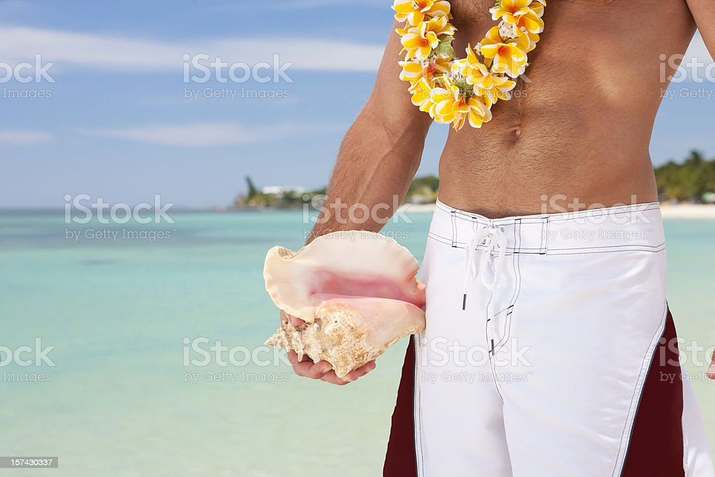 Vacation Lifestyles-Man Holding Conk Shell royalty-free stock photo