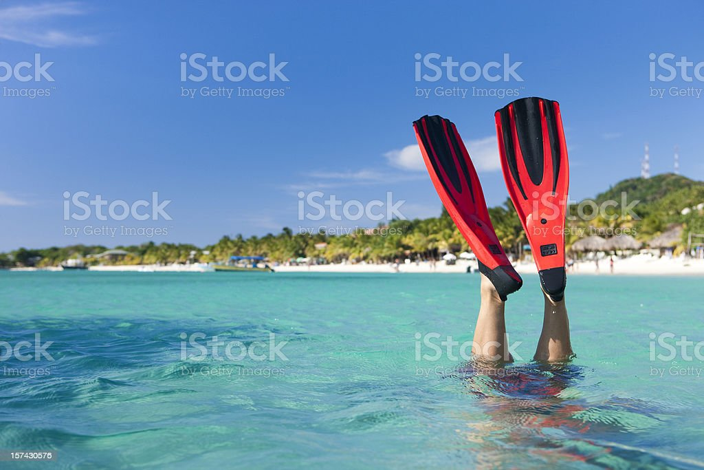 Vacation Lifestyles-Snorkeler Diving in Ocean stock photo