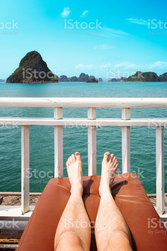 Vacation on Halong Bay personal point of view with legs stock photo