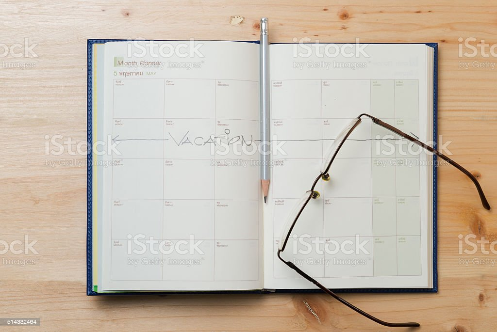 Vacation plan written on calendar stock photo