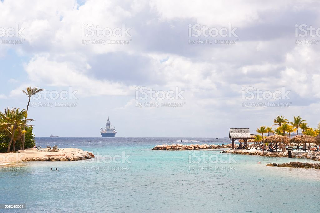 Vacation Resort with View of an Oil Rig stock photo