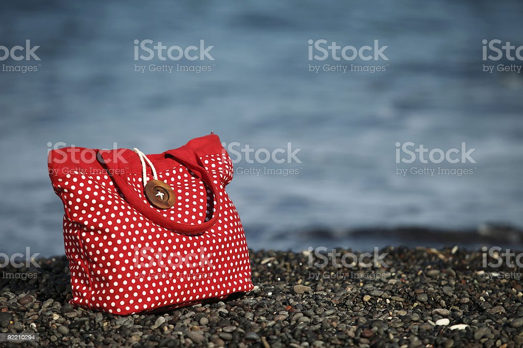 Vacation, shopping bag on the Greek Island beach royalty-free stock photo