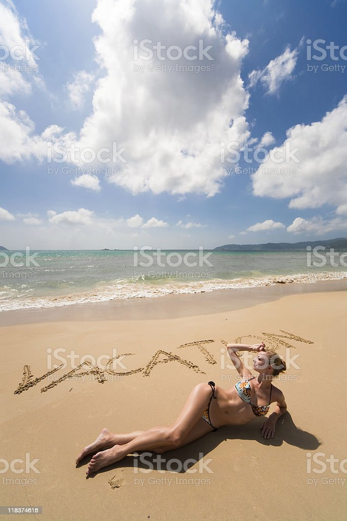 Vacation sing and woman on the beach stock photo